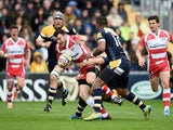 Shane Monahan of Gloucester is tackled by Chris Pennell of Worcester Warriors during the Aviva Premiership match between Worcester Warriors and Gloucester at Sixways Stadium on May 10, 2014