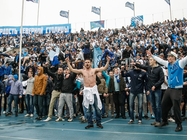 FC Zenit St. Petersburg supporters' react during the Russian Football League Championship match between FC Zenit St. Petersburg and FC Dynamo Moscow at the Petrovsky stadium on May 11, 2014