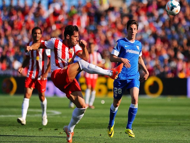 Almeria's defender Angel Trujillo (L) vies with Athletic Bilbao's forward Guillermo Fernandez Hierro during the Spanish league football match pm May 18, 2014