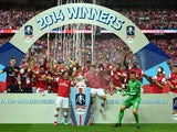 Arsenal players celebrate victory with the trophy after the FA Cup with Budweiser Final match between Arsenal and Hull City at Wembley Stadium on May 17, 2014