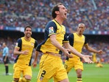 Diego Godin of Club Atletico de Madrid celebrates after scoring his goal during the La Liga match between FC Barcelona and Club Atletico de Madrid at Camp Nou on May 17, 2014
