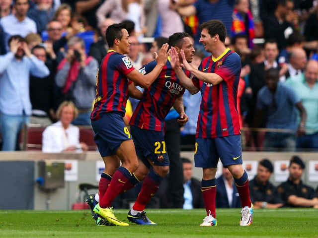 Alexis Sanchez of FC Barcelona celebrates with Lionel Messi after scoring the opening goal during the La Liga match between FC Barcelona and Club Atletico de Madrid at Camp Nou on May 17, 2014