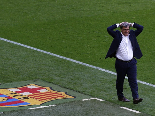 Barcelona's Argentinian coach Gerardo 'Tata' Martino reacts during the Spanish league football match FC Barcelona vs Club Atletico de Madrid at the Camp Nou stadium in Barcelona on May 17, 2014