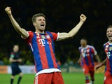 Bayern Munich's midfielder Thomas Muller celebrates scoring the second goal during the extra-time of the DFB German Cup final football match BVB Borussia Dortmund vs Bayern Munich at the Olympic Stadium in Berlin on May 17, 2014