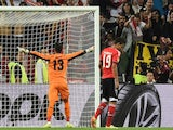 Sevilla's Portuguese goalkeeper Beto (L) celebrates after Benfica's Spanish forward Rodrigo Machado misses a penalty during the penalty shoot out during the UEFA Europa league final on May 14, 2014