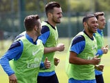 Arsenal's Carl Jenkinson, Alex Oxlade-Chamberlain, Jack Wilshere take part in training on May 14, 2014.