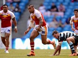 Jeff Lima of Catalan Dragons gets past Nick Slyney of London Broncos during the Super League match between London Broncos and Catalan Dragons at Etihad Stadium on May 17, 2014