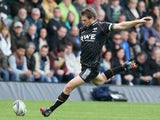 Dan Biggar of the Ospreys kicks a penalty during the Heineken Cup pool 1 match between Northampton Saints and Ospreys at Franklin's Gardens on October 20, 2013