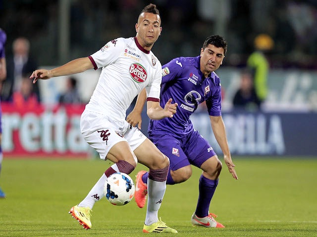 David Pizarro of ACF Fiorentina fights for the ball with Omar El Kaddouri of Torino FC during the Serie A match on May 18, 2014