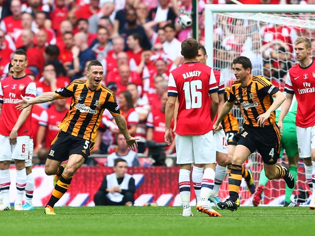 James Chester of Hull City celebrates as he scores their first goal during the FA Cup with Budweiser Final match between Arsenal and Hull City at Wembley Stadium on May 17, 2014
