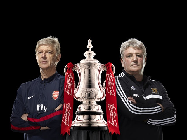 Aresnal manager Arsene Wenger and Hull City manager Steve Bruce pose with the FA Cup trophy ahead of the 2014 final