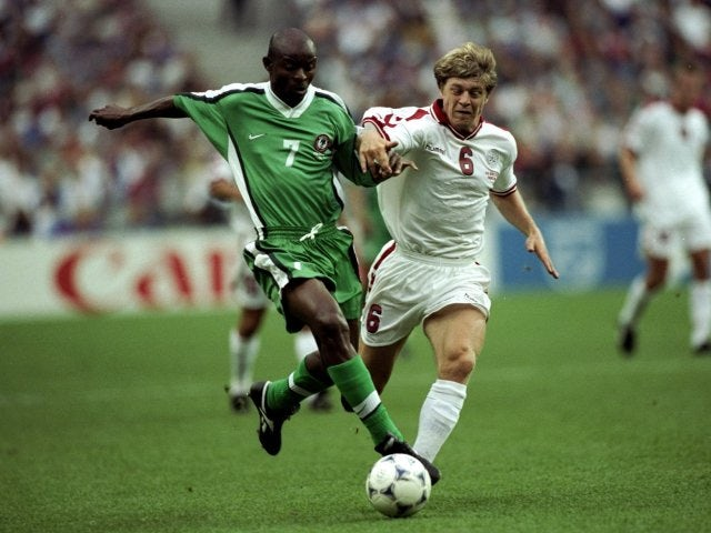 Winger Finidi George in action for Nigeria against Denmark on June 28, 1998.