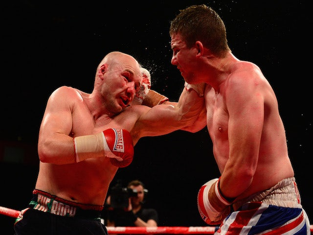 Gavin Rees (L) in action against Gary Buckland during their Lightweight bout at the Motorpoint Arena on May 17, 2014
