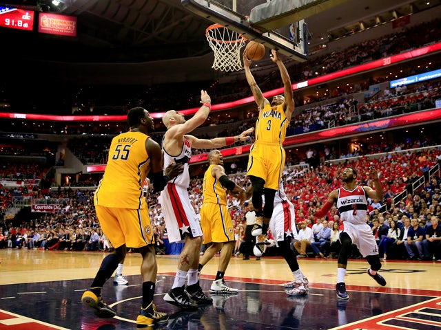 George Hill #3 of the Indiana Pacers drives to the basket againt the Washington Wizards during Game Six of the Eastern Conference Semifinals during the 2014 NBA Playoffs at Verizon Center on May 15, 2014