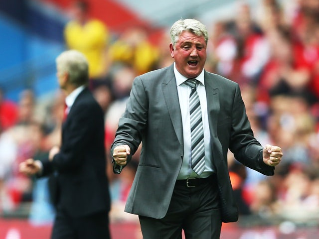 Steve Bruce, manager of Hull City celebrates during the FA Cup with Budweiser Final match between Arsenal and Hull City at Wembley Stadium on May 17, 2014