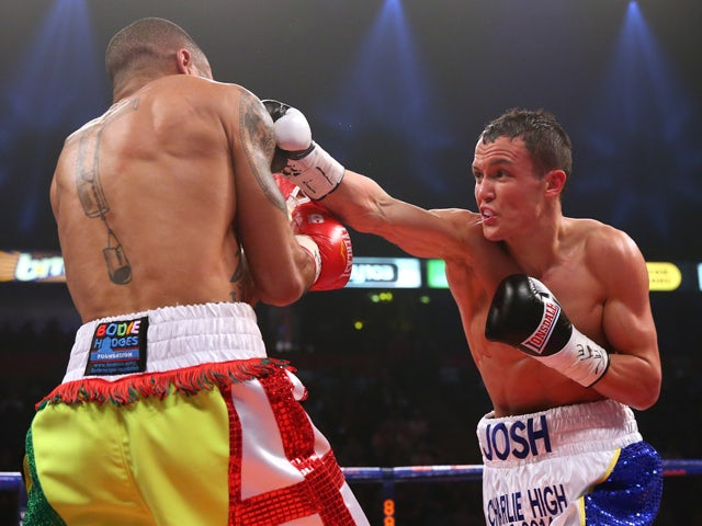 Josh Warrington lands a right hand on Rendall Munroe during the Commonwealth Featherweight Title fight between Josh Warrington and Rendall Munroe at MEN Arena on April 19, 2014