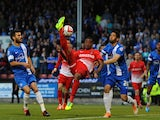 Kevin Lisbie of Leyton Orient challenges for the ball with Nathaniel Knight-Percival of Peterborough United during the Sky Bet League One play-off semi-final second leg match on May 13, 2014