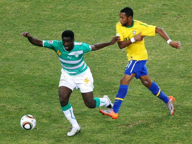 Ivory Coast centre-back Kolo Toure keeps possession from Brazilian attacker Robinho on June 20, 2010.