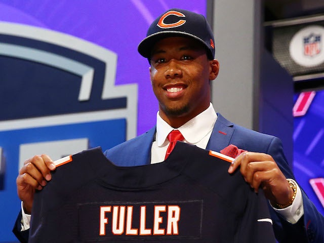 Kyle Fuller of the Virginia Tech Hokies poses with a jersey after he was picked #14 overall by the Chicago Bears during the first round of the 2014 NFL Draft  on May 8, 2014