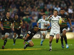 Mathew Tait of Leicester Tigers avoids a tackle from Kahn Fotuali'i of Northampton Saints during the Aviva Premiership Semi Final match between Northampton Saints and Leicester Tigers at Franklin's Gardens on May 16, 2014
