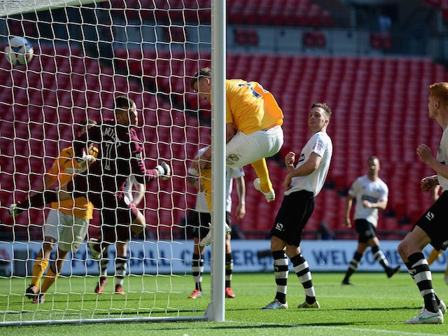 Liam Hughes of Cambridge United scores a goal during the Skrill Conference Premier Play-Offs Final between Cambridge United and Gateshead FC at Wembley Stadium on May 18, 2014