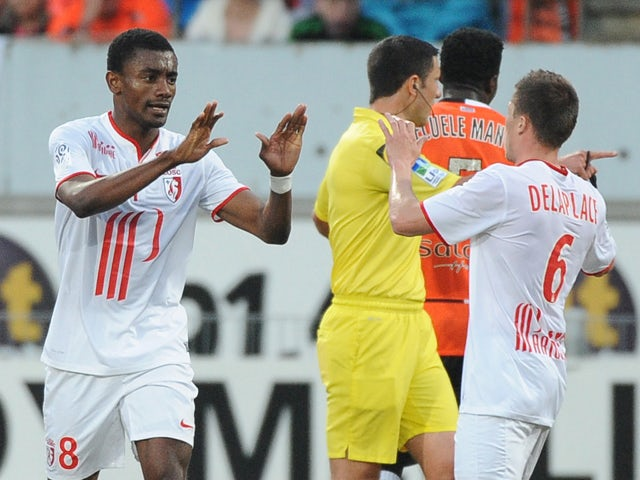 Lille's Ivorian forward Salomon Kalou celebrates after scoring with his teammate Lille's French midfielder Jonathan Delaplace during the French L1 football match Lorient vs Lille on May 17, 2014