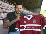 Northampton Town new signing Marc Richards poses with a shirt during a photo call at Sixfields on May 14, 2014