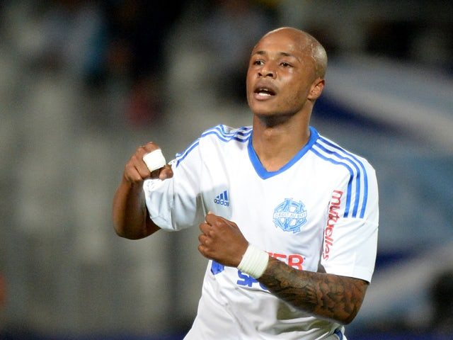 Marseille's Ghanaian forward Andre Ayew jubilates after scoring, during the French L1 football match between Marseille (OM) and Guingamp at the Velodrome stadium in Marseille on May 17, 2014