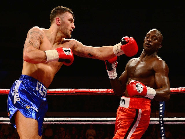 Nathan Cleverly (L) in action against Shaun Corbin during their WBA Inter-Continental Cruiserweight Title bout at the Motorpoint Arena on May 17, 2014