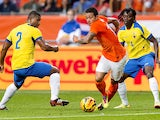 Dutch national team player Memphis Depay vies with Ecuador's Jorge Guagua and Juan Paredes during the friendly football match between Holland and Ecuador in Amsterdam, the Netherlands, on May 17, 2014