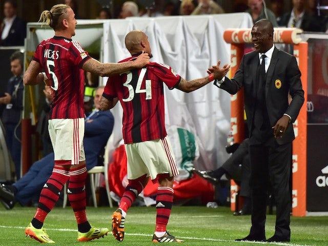 AC Milan's Dutch midfielder Nigel de Jong (C) celebrates after scoring a goal with AC Milan's Dutch coach Clarence Seedorf on May 18, 2014