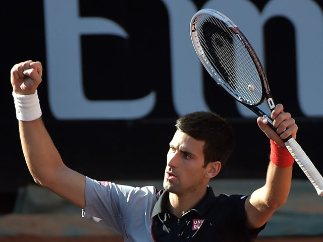 Novak Djokovic of Serbia celebrates after winning the ATP-WTA Rome's Tennis Masters semi-final against Milos Raonic of Canada on May 17, 2014