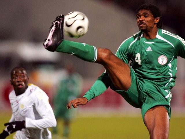 Former Arsenal striker Nwankwo Kanu in action for Nigeria on January 31, 2006.