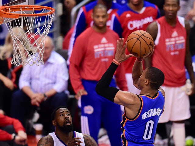 Russell Westbrook of the Oklahoma City Thunder jumps over Blake Griffin of the Los Angeles Clippers while attempting to score in the fourth quarter on May 15, 2014