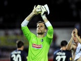 Freiburg's goalkeeper Oliver Baumann acknowledges the crowd at the end of the UEFA Europa league, group H, football match Sevilla FC vs SC Freiburg at the Ramon Sanchez Pizjuan stadium in Sevilla on October 3, 2013