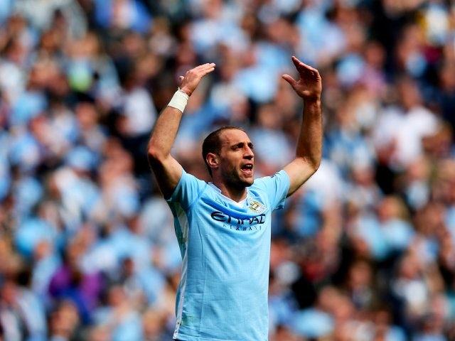 Pablo Zabaleta celebrates scoring for Manchester City against Queens Park Rangers on May 13, 2012.