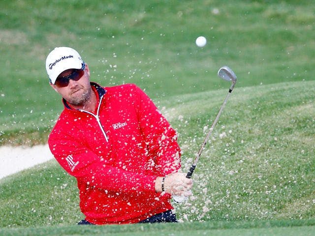 Peter Hanson of Sweden plays a shot on the 13th hole during the second round of the HP Byron Nelson Championship at the TPC Four Seasons Resort on May 16, 2014