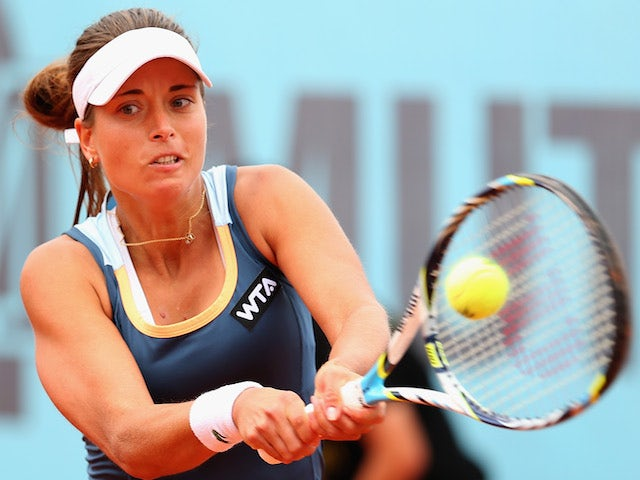 Petra Cetkovska of the Czech Republic plays a forehand against Sloane Stephens of the United States in their second round match during day four of the Mutua Madrid Open on May 6, 2014