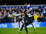 Charlie Austin of Queens Park Rangers scores QPR's 2nd goal in extra time during the Sky Bet Championship Play Off Semi Final second leg match between Queens Park Rangers and Wigan Athletic at Loftus Road on May 12, 2014
