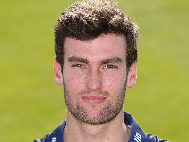 Reece Topley of Essex poses during the Essex County Cricket Club Photocall at the County Ground on April 1, 2014