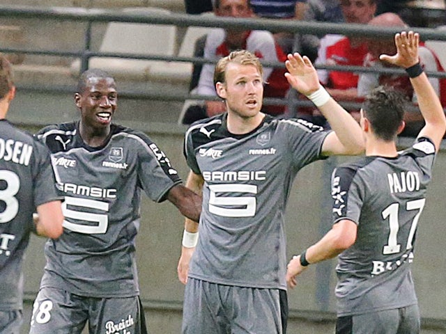 Rennes' teammates celebrate after Rennes' forward Ola Toivonen (2nd R) scores a goal during the French L1 football match between Reims and Rennes, on May 17, 2014