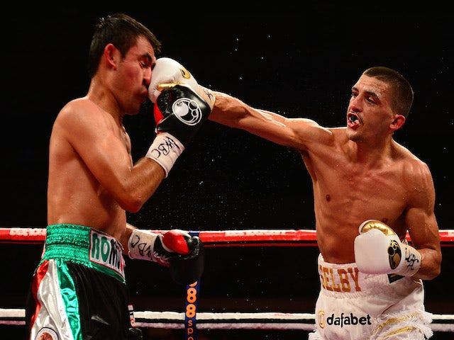 Lee Selby (R) in action against Romulo Koasicha during their WBC International Featherweight Title bout at the Motorpoint Arena on May 17, 2014