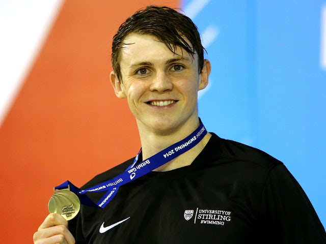 Ross Murdoch poses with his medal on the podium after winning the Men's 100m Breaststroke Final on day three of the British Gas Swimming Championships 2014 at Tollcross International Swimming Centre on April 12, 2014
