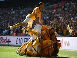 Ryan Donaldson of Cambridge United celebrates his goal with team mates during the Skrill Conference Premier Play-Offs Final against Gateshead on May 18, 2014