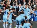 Manchester City players celebrate Sergio Aguero's late title-clinching goal against Queens Park Rangers on May 13, 2012.