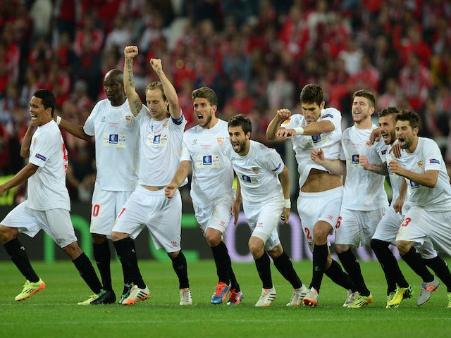 Sevilla players celebrate after Kevin Gameiro of Sevilla (not pictured) scores the winning penalty in the shoot out during the UEFA Europa League Final match on May 14, 2014