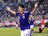 Manchester United playmaker Shinji Kagawa celebrates scoring for Japan against South Korea on August 10, 2011.