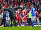 Brian Easton and manager Tommy Wright of St Johnstone celebrate their teams famous win during the William Hill Scottish Cup Semi Final between St Johnstone and Aberdeen at Ibrox Stadium on April 13, 2014