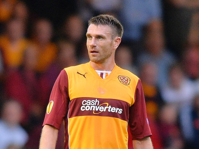 Stephen McManus of Motherwell in action during the UEFA Europa League Third Round Qualifying First Leg match between Motherwell and Kuban Krasnodar at Fir Park Stadium on August 01, 2013