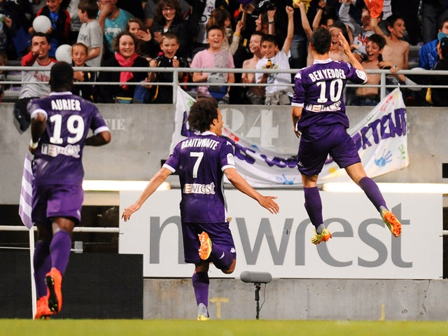 Toulouse's French forward Wissam Ben Yedder celebrates after scoring a goal during the French L1 football match, Toulouse vs Valenciennes in Toulouse, on May 17, 2014